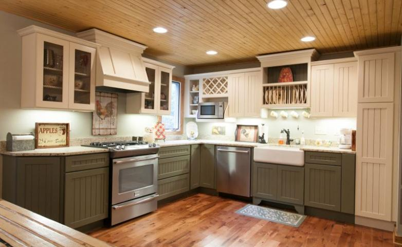 <span>Hendersonville Kitchen Remodel:</span> Farm sink, recessed lights, stainless appliances, granite counter tops, painted cabinetry.